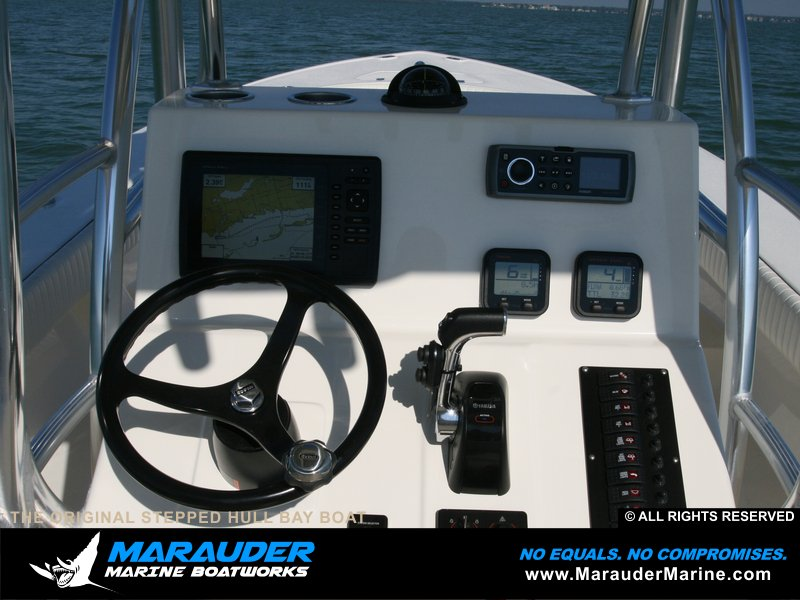 Custom marine electronics photo mounted to dash in Stepped Hull Bay Boats photo gallery from Marauder Marine Boat Works