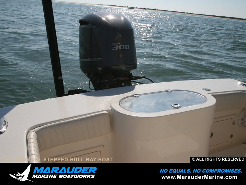 Round sided bait well shown with power pole and skinny water in Stepped Hull Bay Boats photo gallery from Marauder Marine Boat Works