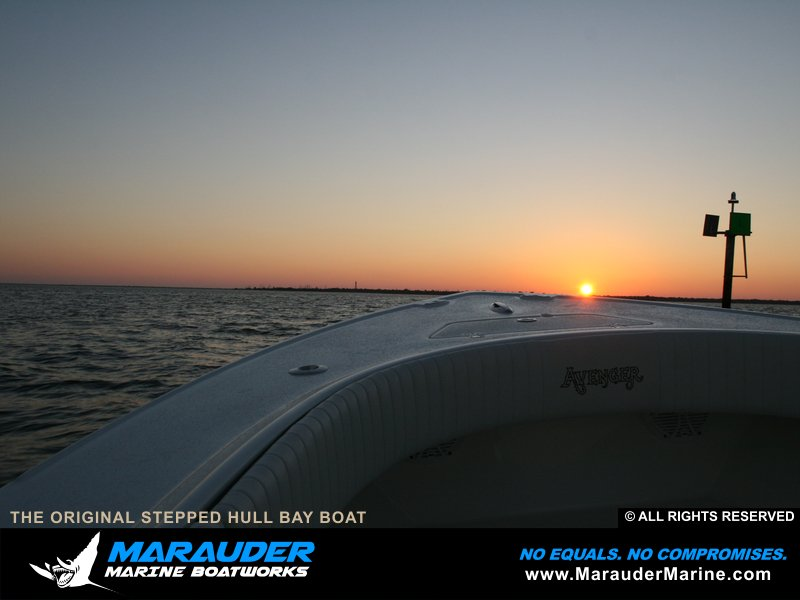 Photo of sunrise on custom bay boat headed for a trip in Stepped Hull Bay Boats photo gallery from Marauder Marine Boat Works