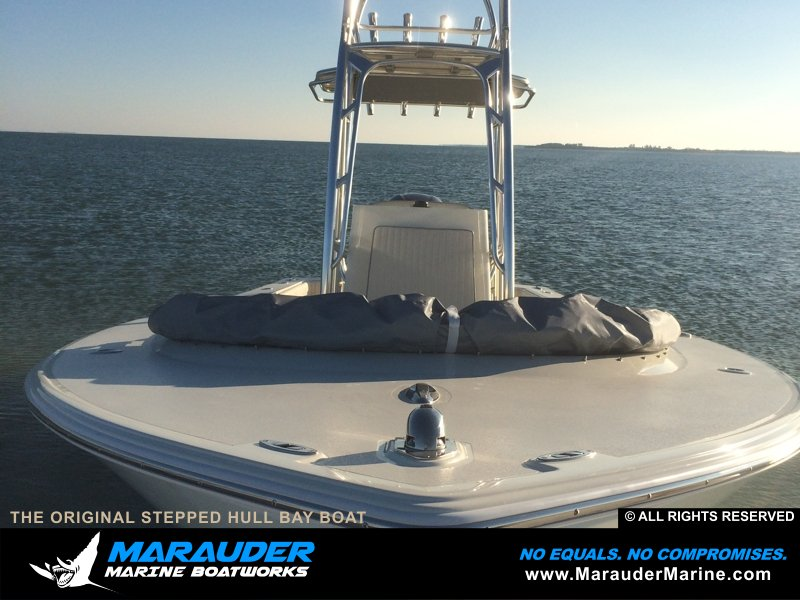 Side view of stepped hull skinny water boat in Stepped Hull Bay Boats photo gallery from Marauder Marine Boat Works
