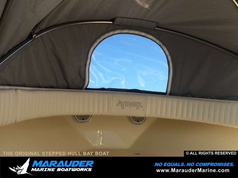 Custom front cover / tent on custom bay fishing boat in Stepped Hull Bay Boats photo gallery from Marauder Marine Boat Works