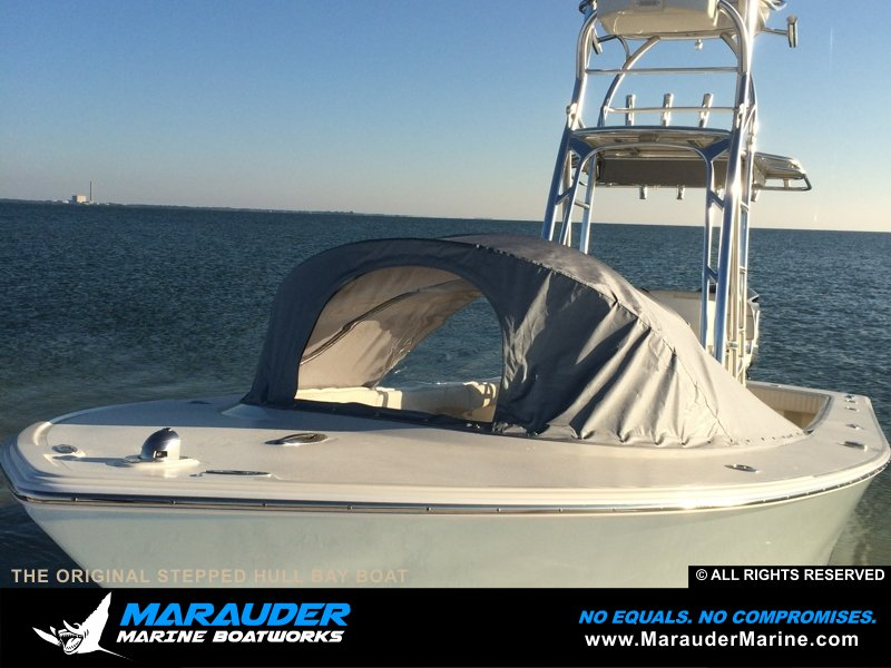 Photo of boat with front tent cover protection in Stepped Hull Bay Boats photo gallery from Marauder Marine Boat Works